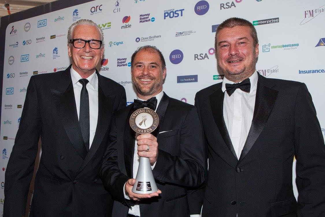 Alec Tarrant, Jeremy Hyams and Matt Brady receive the trophy for Digital Insurance Innovation of the Year 2016